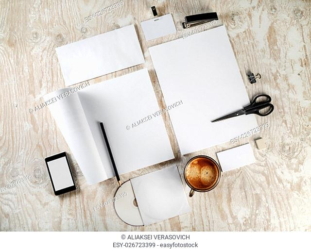 Photo of blank stationery set on light wooden background. Corporate identity template. Mock-up for design presentations and portfolios
