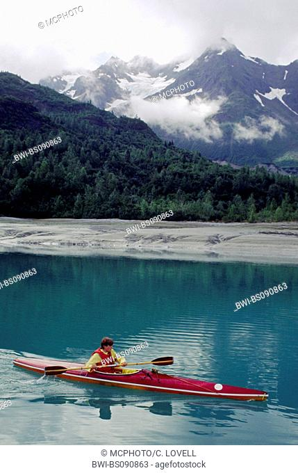 A Kayaker surrounded by the majestic serenity of Adams inlet, USA, Alaska, Glacier Bay National Park