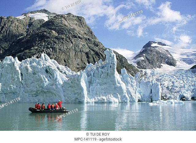 TOURISTS AT TIDEWATER GLACIER, SOUTHERN GREENLAND FJORDS, PRINCE CHRISTIAN SOUND, GREENLAND