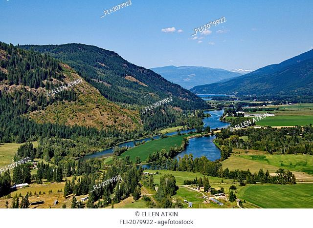 Aerial view of the north Okanogan Valley inthe summer in British columbia. The Shuswap river curves its way through farm land heading towards Mara Lake