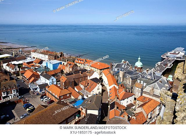 Rooftops and the Pier from St Peter and St Paul Church Tower at Cromer Norfolk England