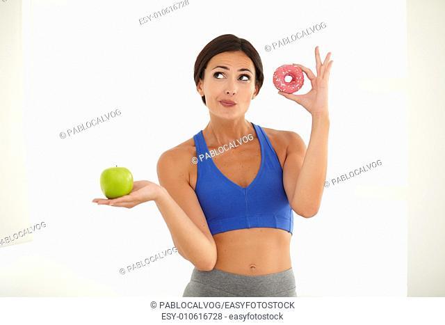 Slim energetic lady standing and holding food - copyspace