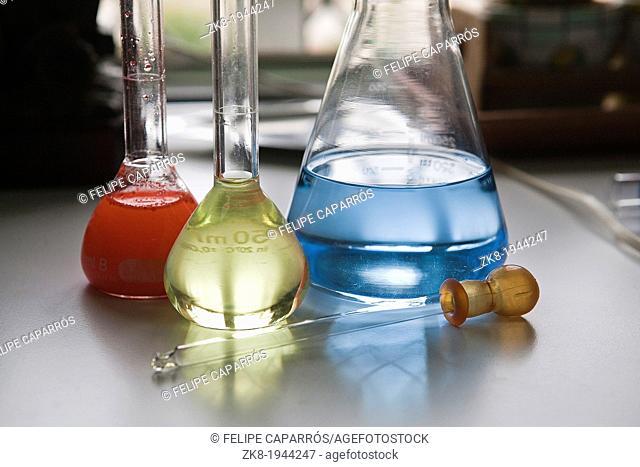 chemical laboratory flasks containing liquid shiny