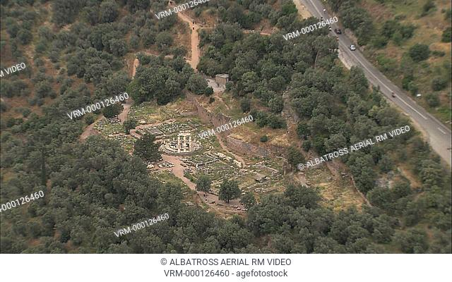 Aerial HD video of Delfi, Delphi archaeological site - a the Tholos the base of mount Parnassus