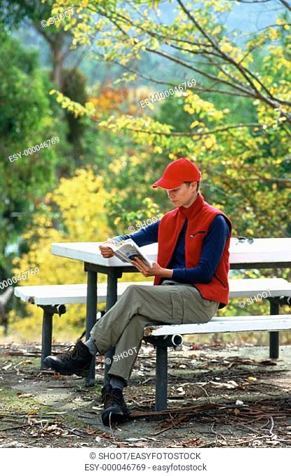 Woman reading at picnic ground