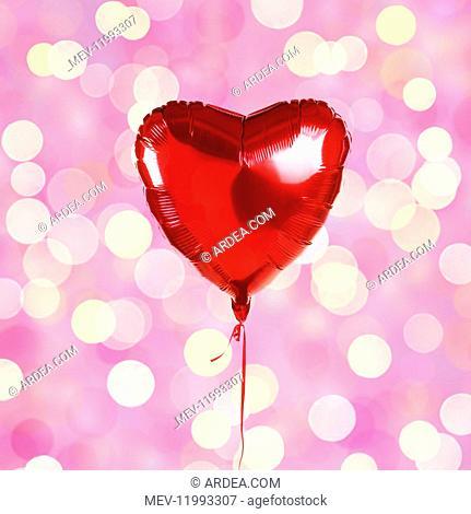 Heart shaped balloon on light background, bokeh