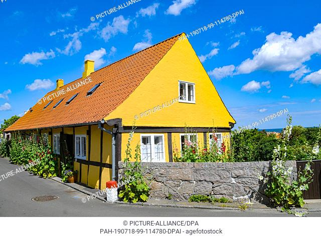 28 June 2019, Denmark, Svaneke: A typical residential house in Svaneke, a small town on the north-eastern edge of the Danish Baltic island of Bornholm