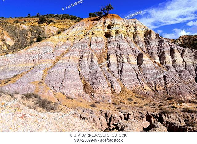 Badlands are a dry terrains formed with softer sedimentary rocks (clay), easy to erode by water or wind. This photo was taken in Tronchon, Teruel, Aragon, Spain