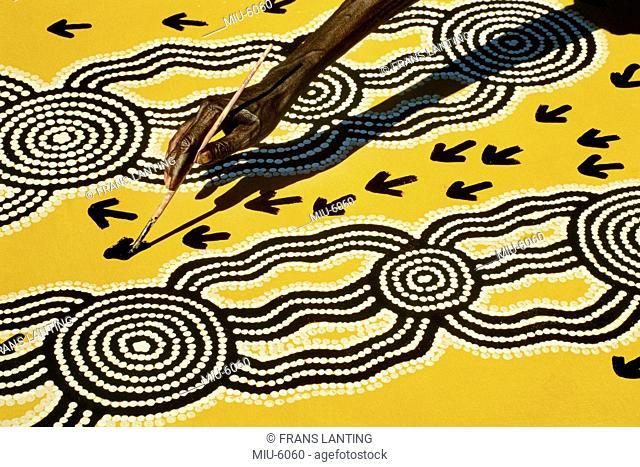 Aboriginal artist at work, Central Desert, Australia