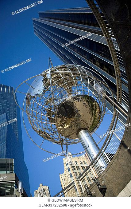 Low angle view of a globe sculpture in front of a building, Columbus Circle, Manhattan, New York City, New York State, USA