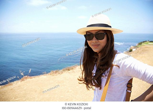 Young woman wearing sunhat at coast Palos Verdes, California, USA