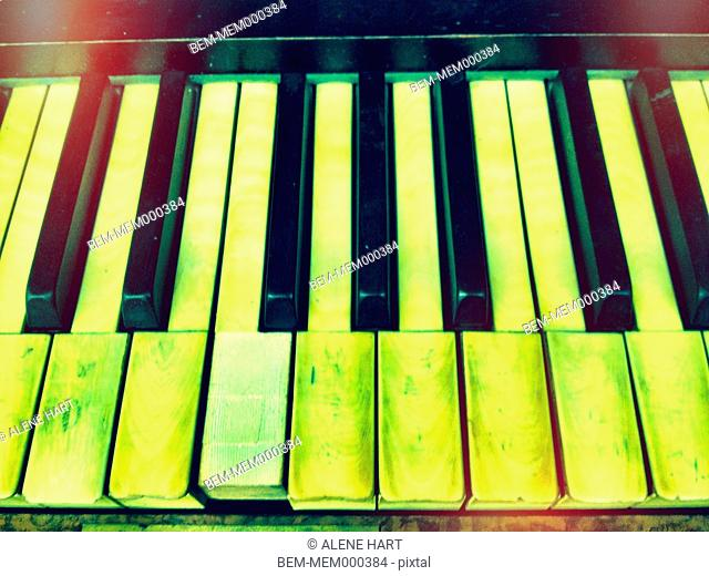 Close up of uneven piano keys