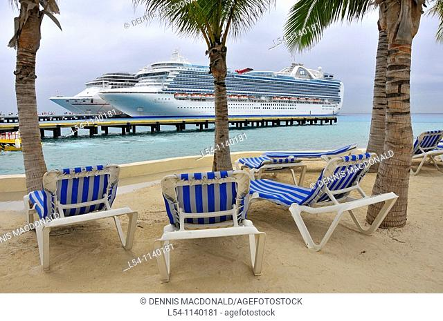 Blue lounge chairs near Caribbean Cruise Ship in Puerta Maya and Cozumel Mexico