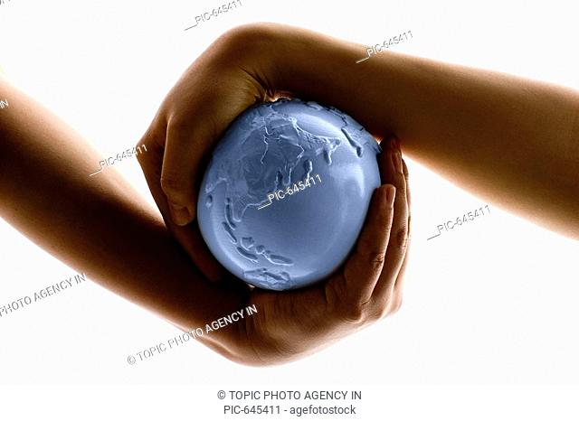 Hands Holding Globe