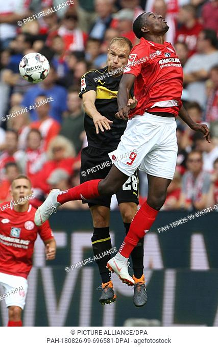 26 August 2018, Germany, Mainz: Soccer, Bundesliga, FSV Mainz 05 vs VfB Stuttgart, 1st matchday in the Opel Arena: Jean-Philippe Mateta (R) from Mainz and...