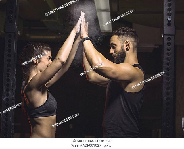 Fitness, couple in gym, high five