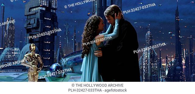 C-3PO (Anthony Daniels) looks on as Padme Amidala (Natalie Portman) and Anakin Skywalker (Hayden Christensen) show their true love for each other in Star Wars:...