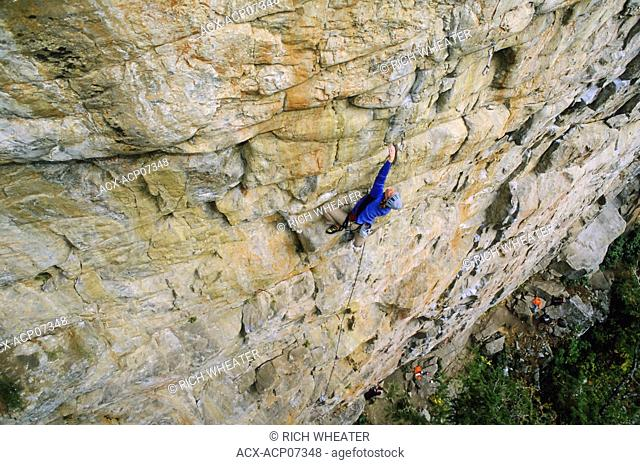 Woman climbing Bob's Yer Apple, 5.11. Maternal Wall, Skaha Bluffs. Penticton, British Columbia, Canada