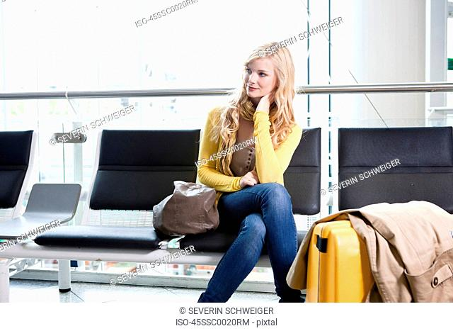 Woman sitting in airport waiting area