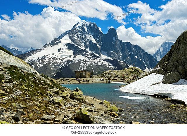 At the mountain lake Lac Blanc in the Aiguilles Rouges National Nature Reserve, peak Aiguille Verte and Les Drus behind, Chamonix, Haute-Savoie department