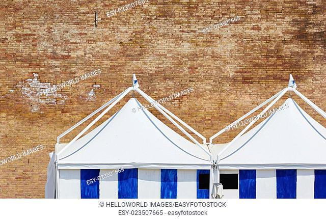 Striped tents and brick wall, Rome, Lazio, Italy, Europe