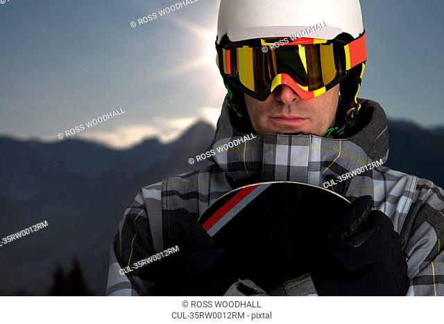 Snowboarder wearing helmet and mask