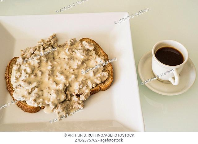 Country sausage gravy on whole wheat toast with espresso coffee