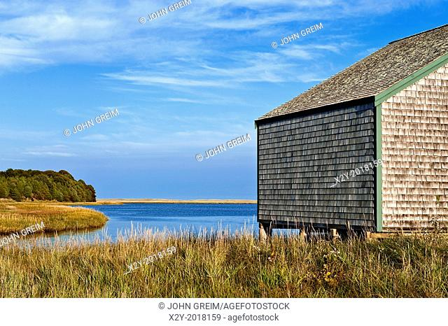 Boathouse on salt pond, Nauset Marsh, Eastham, Cape Cod, Massachusetts, USA