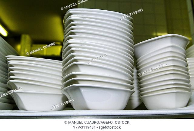 Crockery, cutlery and utensils ready to set restaurant tables