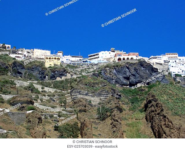 traditional white houses on greece island santorini