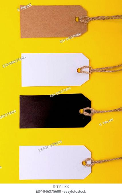 collection of various price label notes on yellow background. view from above