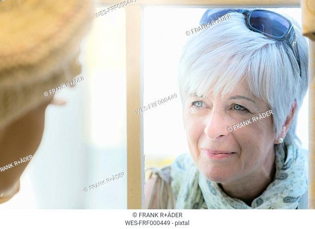 Senior woman looking to display figure