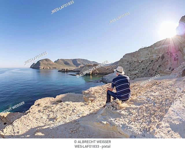 Spain, Andalusia, Cabo de Gata, back view of man looking at the sea