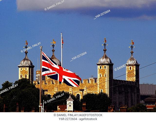 Tower of London with Union Flag in the foreground on a sunny day