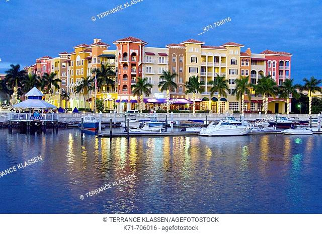 The marina and the Bayfront shopping and dining complex at dusk in Naples, Florida, USA, 2008