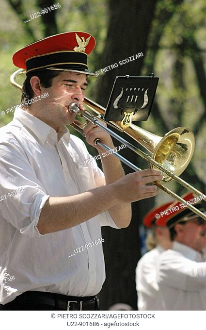 New York City (USA): a man playing trumpet along the 5th Avenue during the Greek Parade