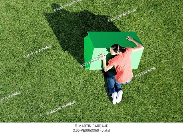 Woman hugging small model house