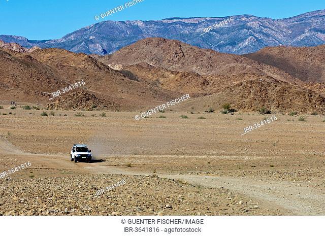 Mitsubishi SUV on a dirt road