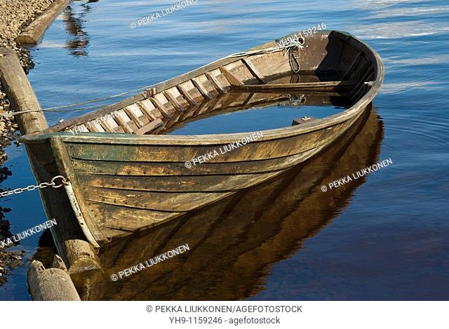 A Wooden Boat Soaking