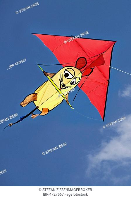 Kite with the Show with the mouse figure, blue sky, Germany