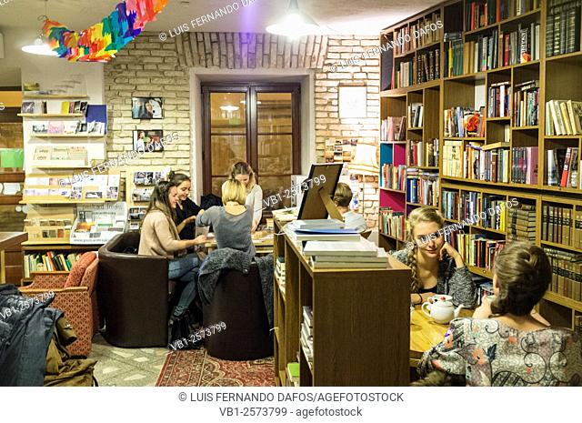 Young women inside Mint Vinetu bookstore and cafe in the old town of Vilnius, Lithuania. Šv. Ignoto g. 16