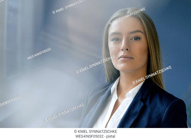 Portrait of serious young businesswoman