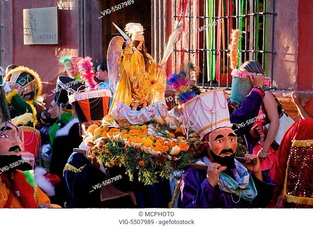 Statue of SAN MIGUEL ARCANGEL is paraded through the streets in celebration each October, the patron saint of SAN MIGUEL DE ALLENDE, MEXICO - , 02/10/2010