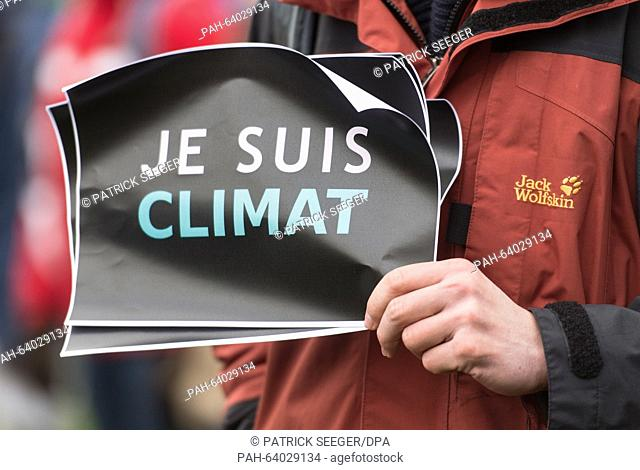 """An environmental protestor holds a sign banner that reads """"""""Je suis climat"""""""" in Freiburg, Germany, 28 November 2015. In the run up to the Climate Summit in..."""