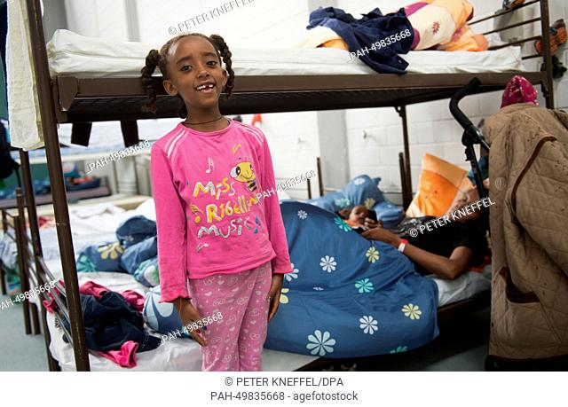 Eliana from Eritrea stands in front of an empty bed at the refugee camp at Bavaria Barracks (Bayern-Kaserne) in Munich, Germany, 30 June 2014