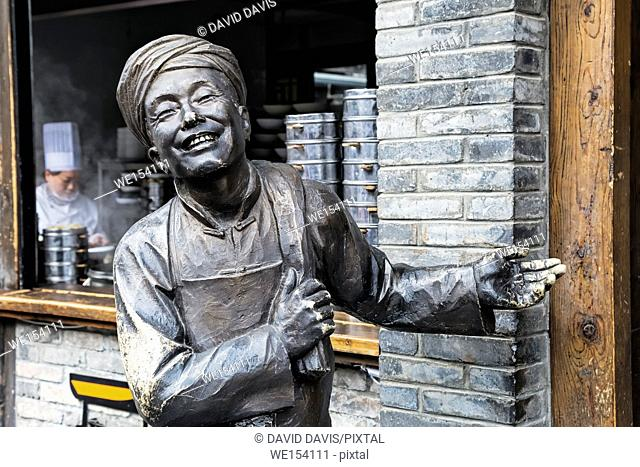 Chengdu China, Statue welcoming tourists into a restaurant along the famous Kuanzhai Alleys in Chengdu, Sichuan province, China