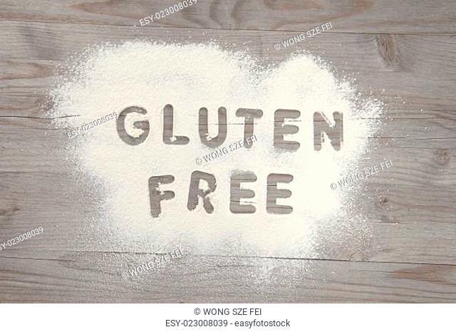 Word gluten free written in white flour