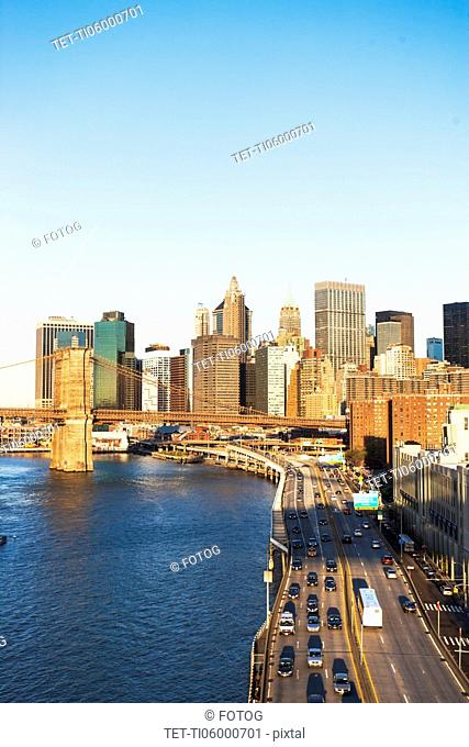 USA, New York State, New York City, Manhattan, Franklin D. Roosevelt East River Drive and Brooklyn Bridge at sunset