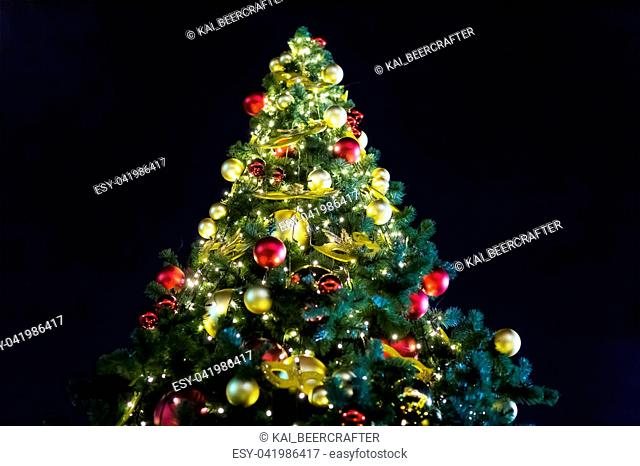 fir Christmas red gold balls mask decoration festive decoration, bright shiny fir-tree on a background of dark night sky