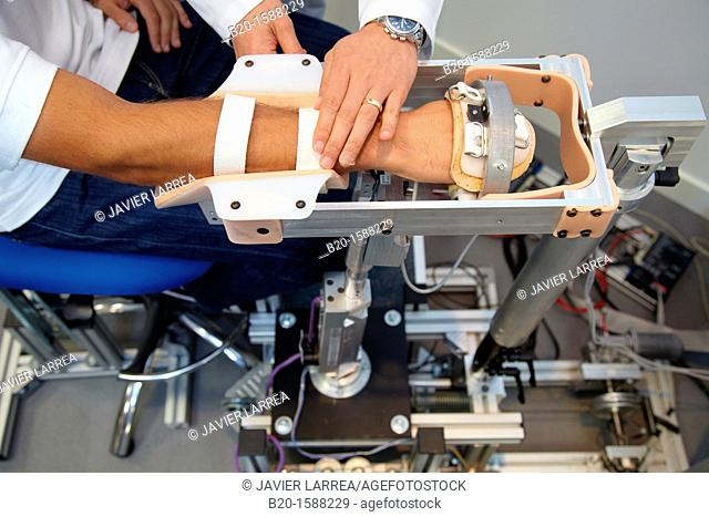 Researcher placing a patient clinical training device of the limb has multiple modes of training wrist and arm  This is a quantitative and repetitive haptic...